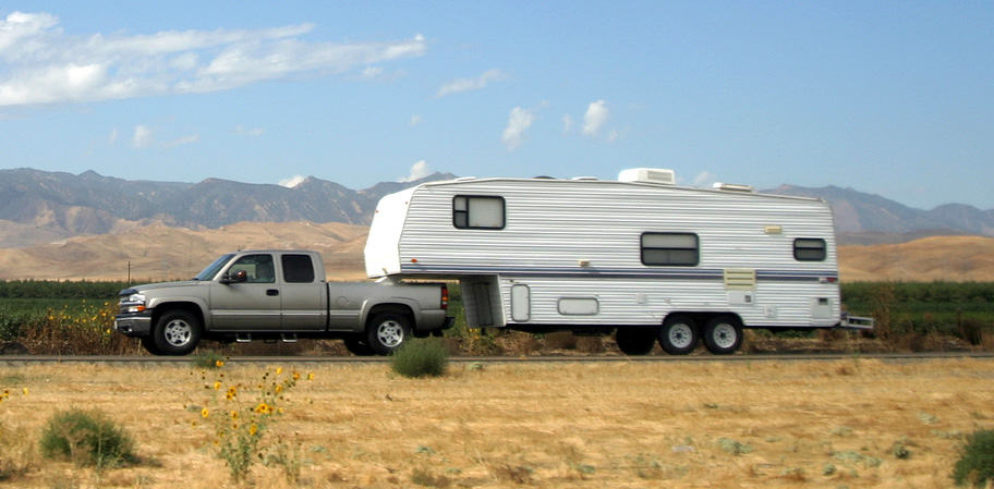 5th wheel trailer towed by a pick up truck