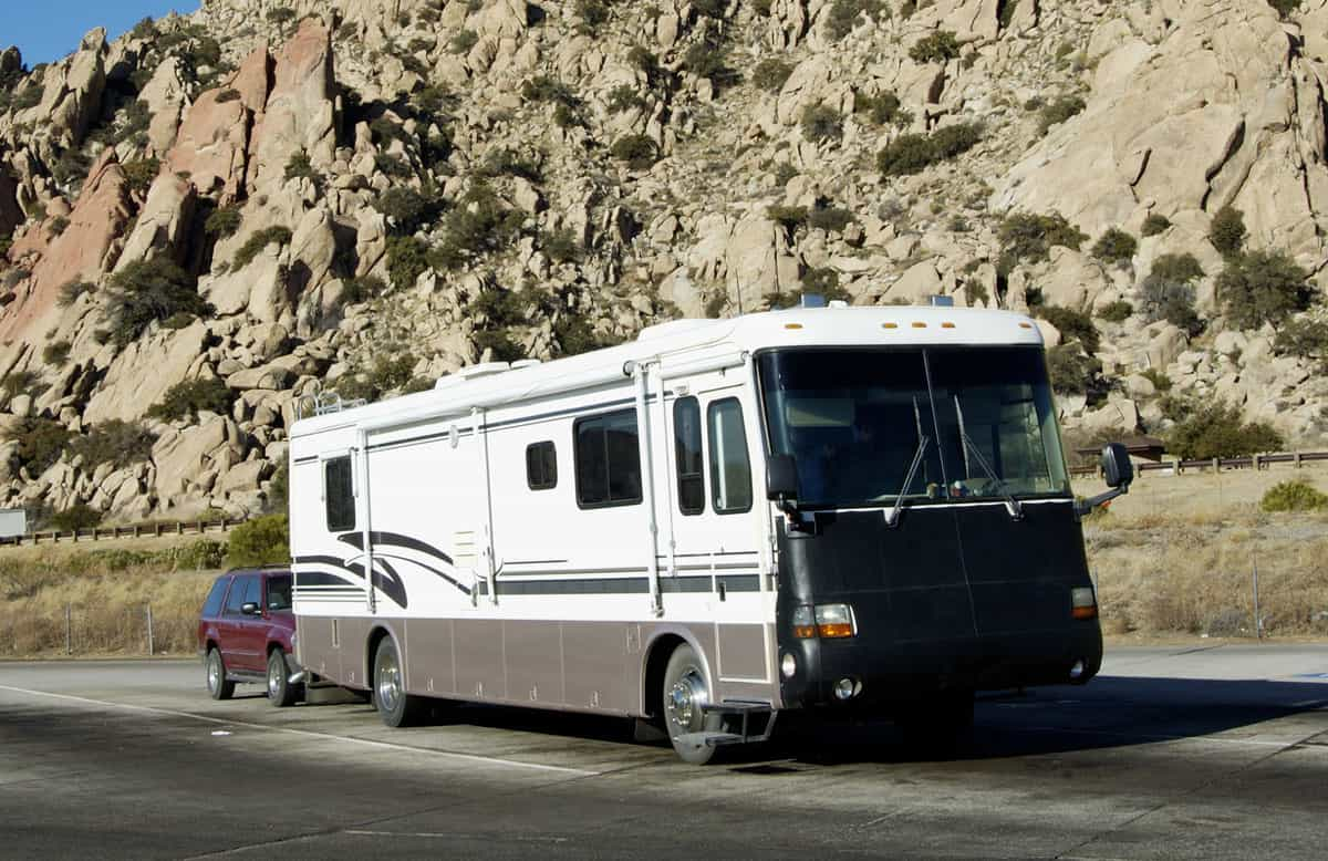 A Class A motorhome with its towed sedan