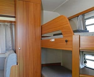 Read more about the article What Is a Bunkhouse Travel Trailer? (Including 12 Real-Life Examples)