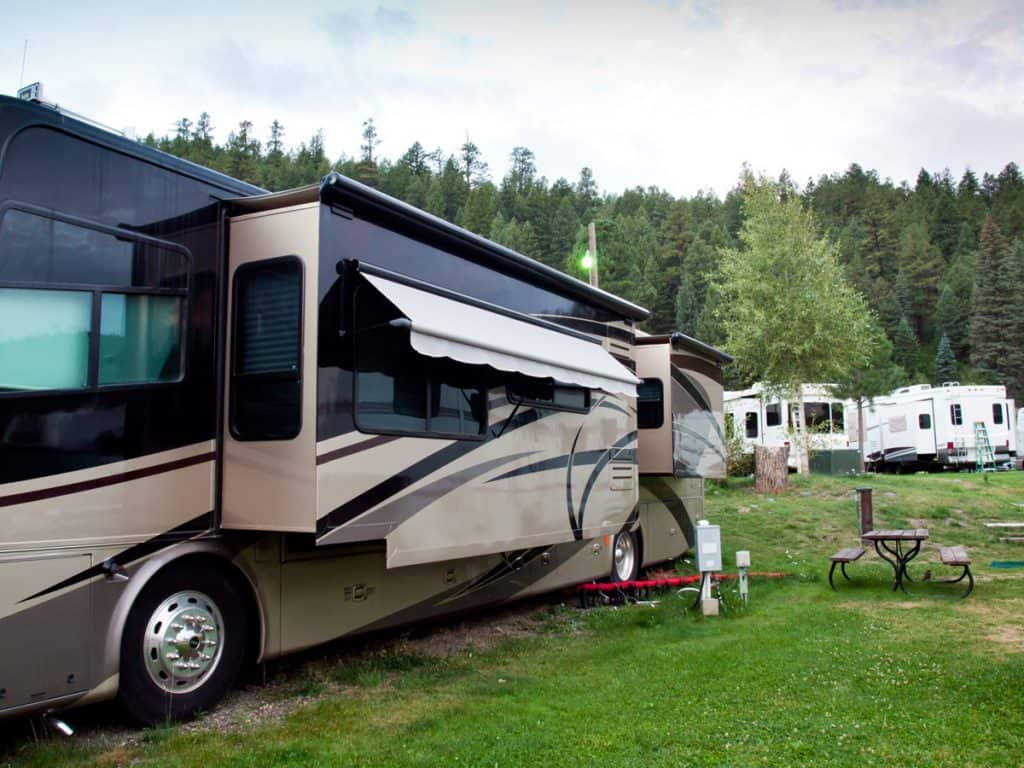 Class A with slides out in a campground