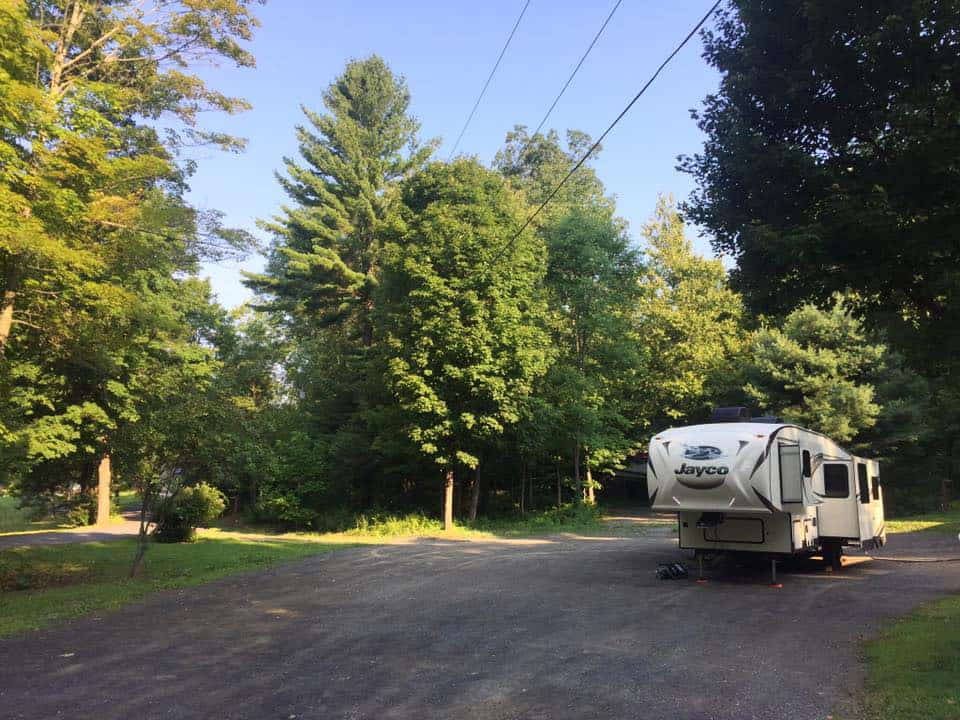 5th wheel RV parked in the forest