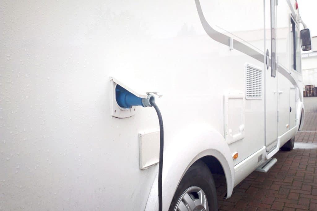 A parked camper van charging its batteries