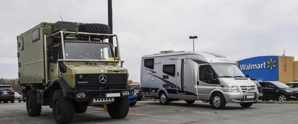 recreational vehicles camping overnight for free in a Walmart parking lot