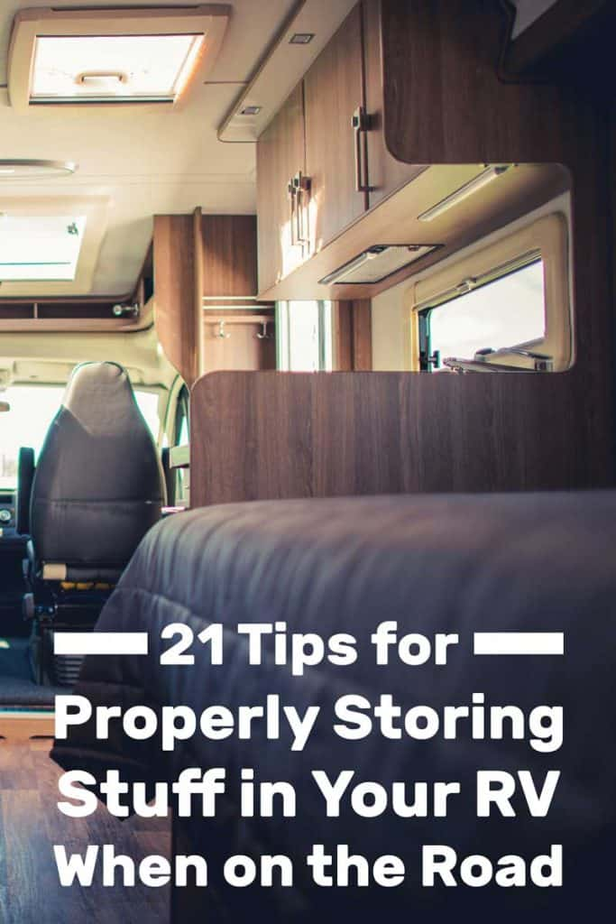Interior of an RV with gray sofas and other mobile furniture's while moving on the road, 21 Tips for Properly Storing Stuff in Your RV When on the Road