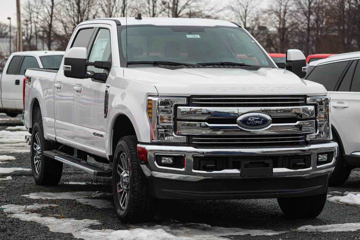 White Ford F-250 pickup truck at a dealership, How Much Does a Ford F150 Weigh?