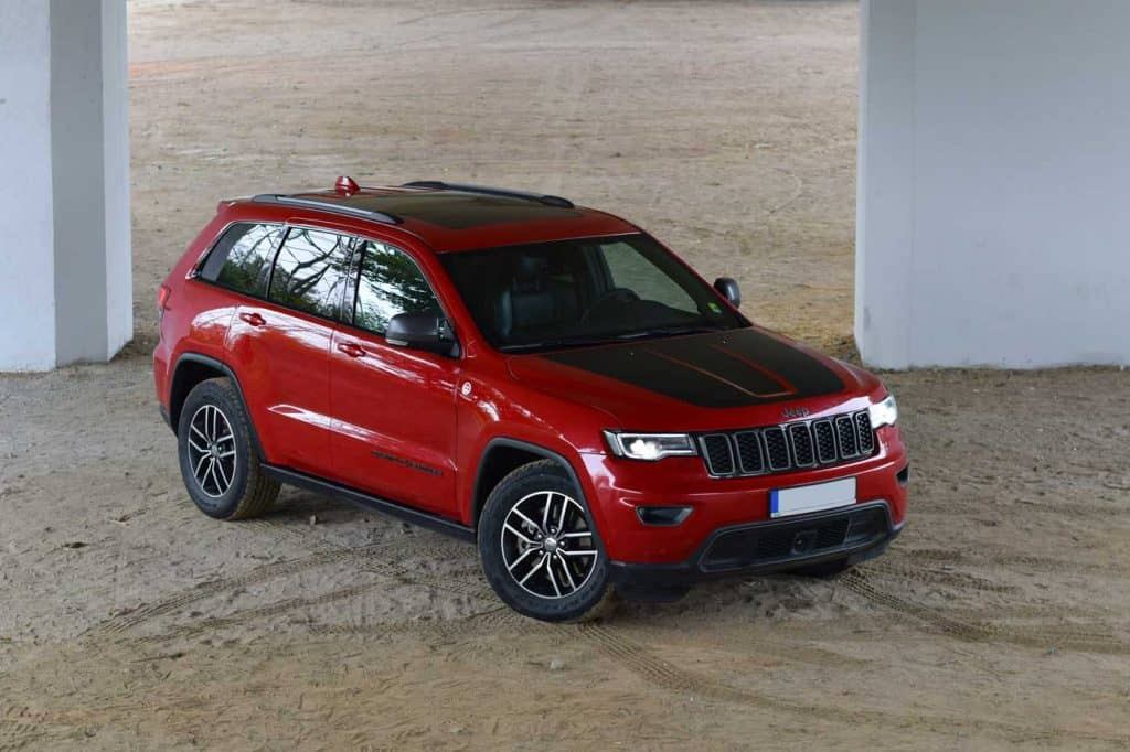Jeep Grand Cherokee on a road. Jeep Grand Cherokee is powered by the 3-liter turbo, direct-injection V6 diesel engine and by three petrol engine options: the 3.6-liter Pentastar V6, the 5.7-liter V8 and the powerful 6.4-liter HEMI V8 engine that powers the high-performance SRT model.