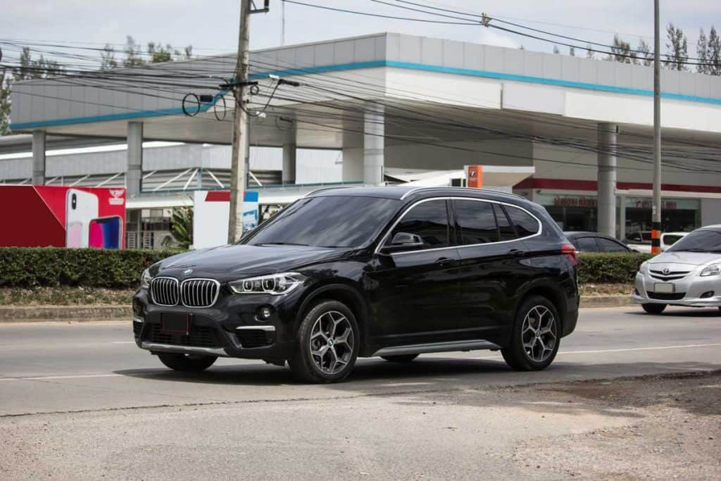2019 Black BMW X1 near gas station