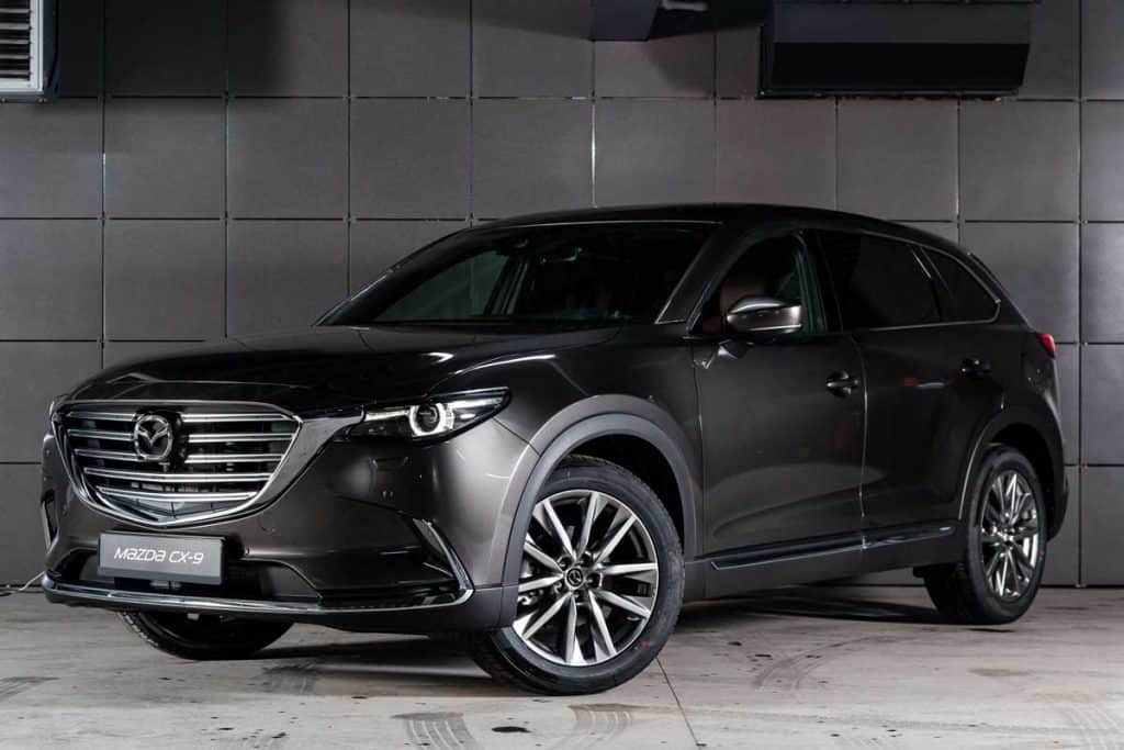 2019 Black Mazda CX-9 with grey tile background