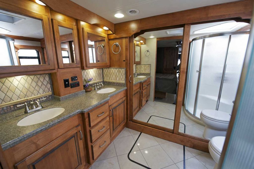 Large RV Bathroom with wooden cabinets, 14 RV's With An Extra Large Bathroom [Illustrated Examples]