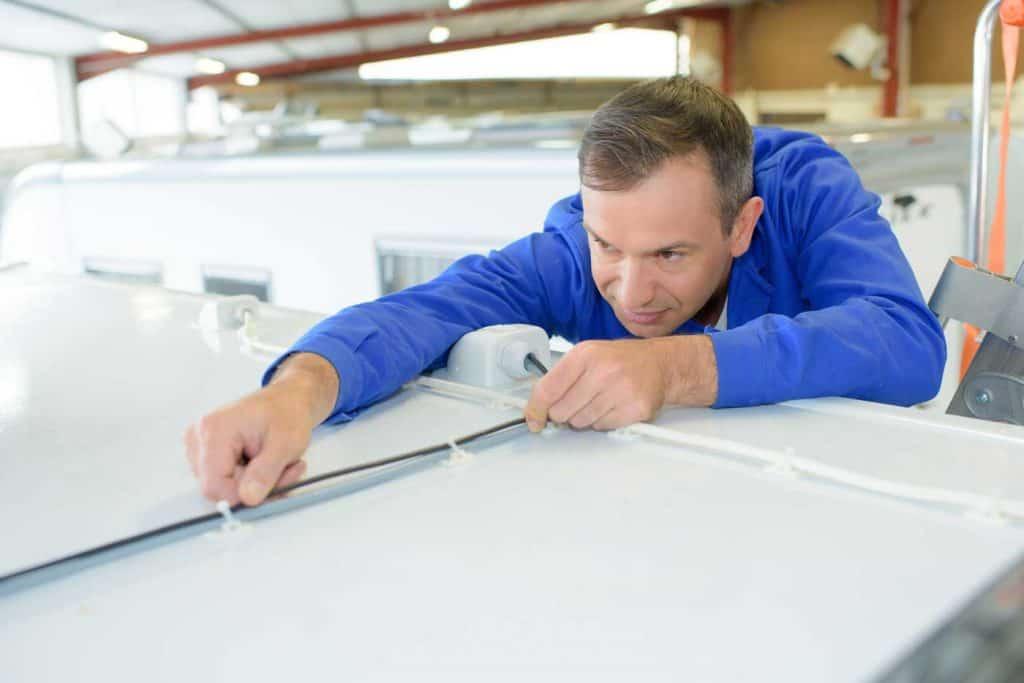 Man repairing the RV roof