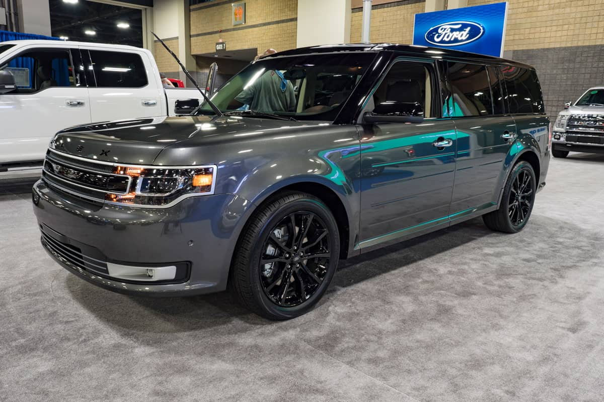 A dark blue colored Ford Flex for sale at a dealership