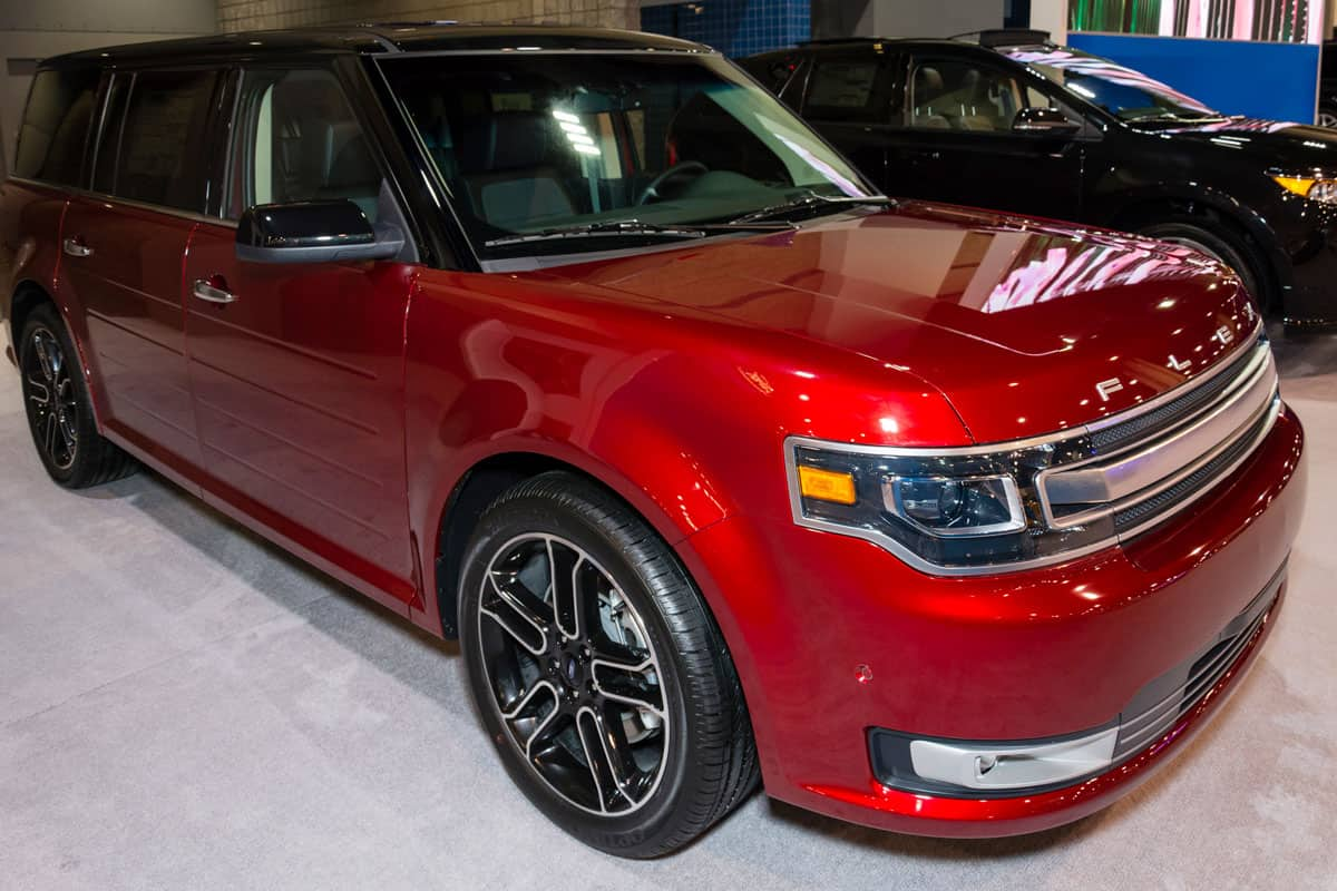 A red Ford Flex at a dealership