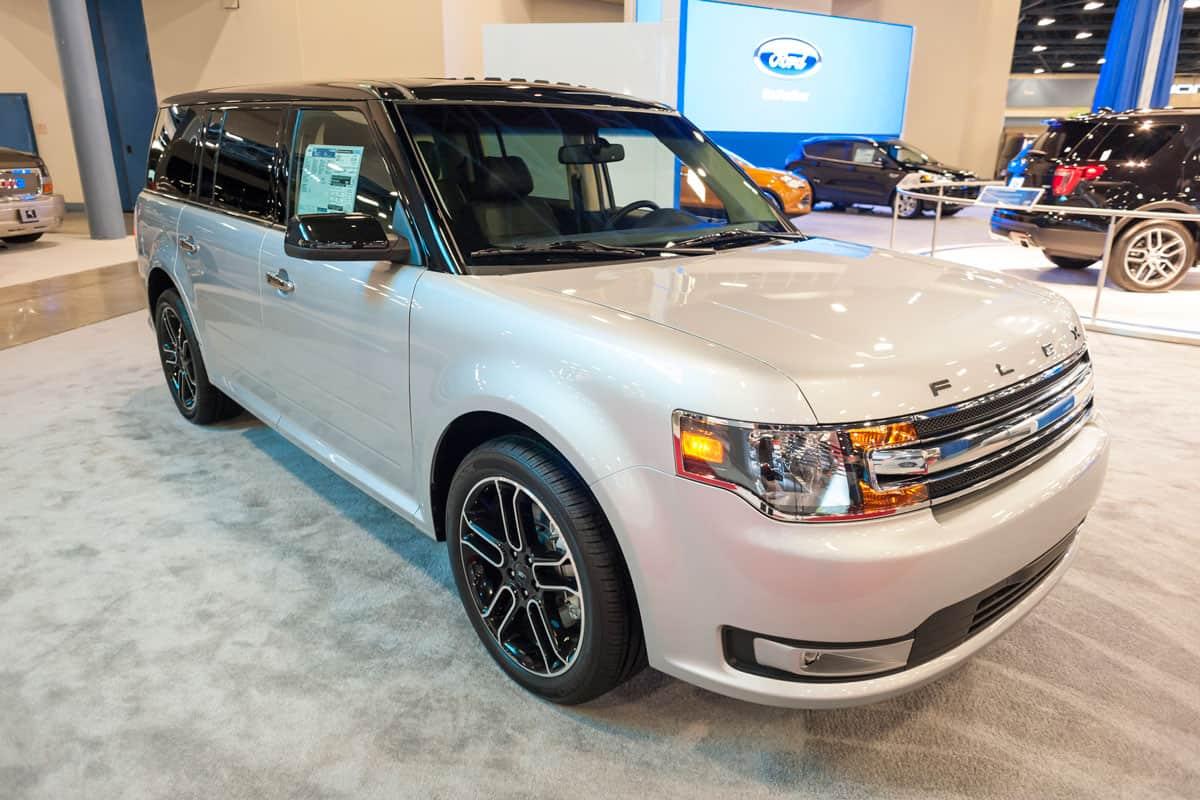 A white Ford Flex at a car show