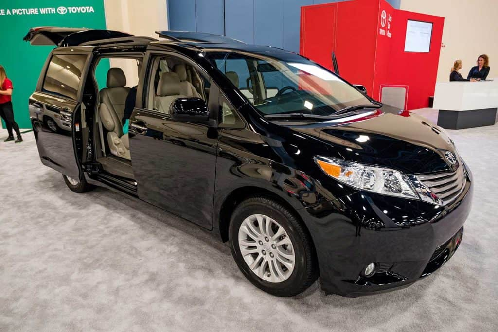 A black Toyota Sienna on display with all doors open