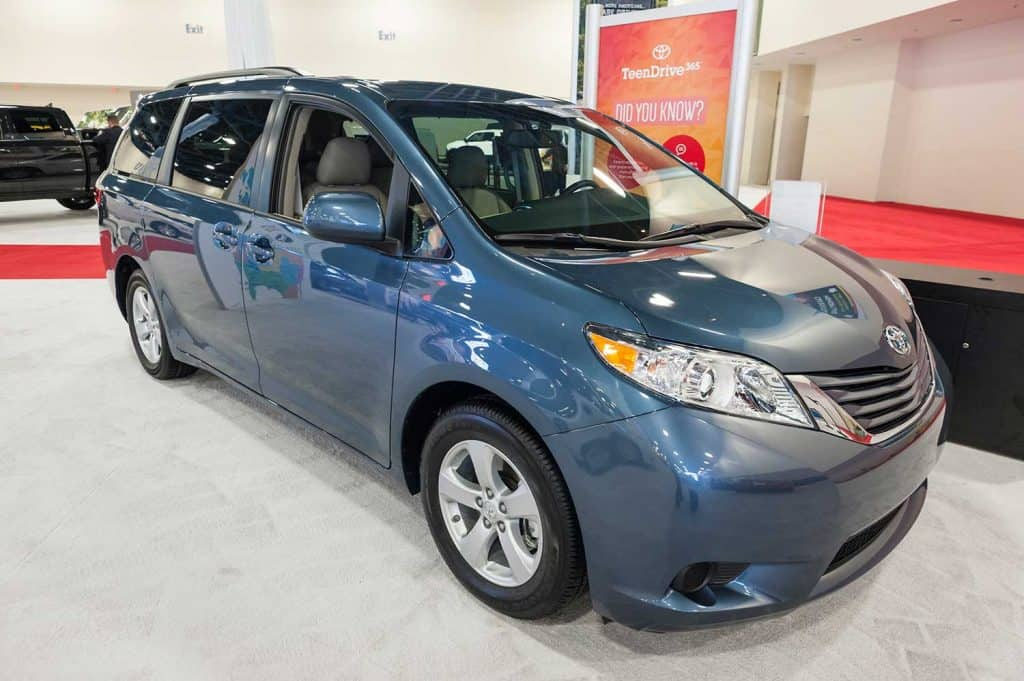 A blue Toyota Sienna on display