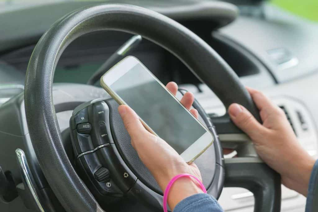 woman driver trying to pair her smartphone to the Dodge Grand Caravan via bluetooth