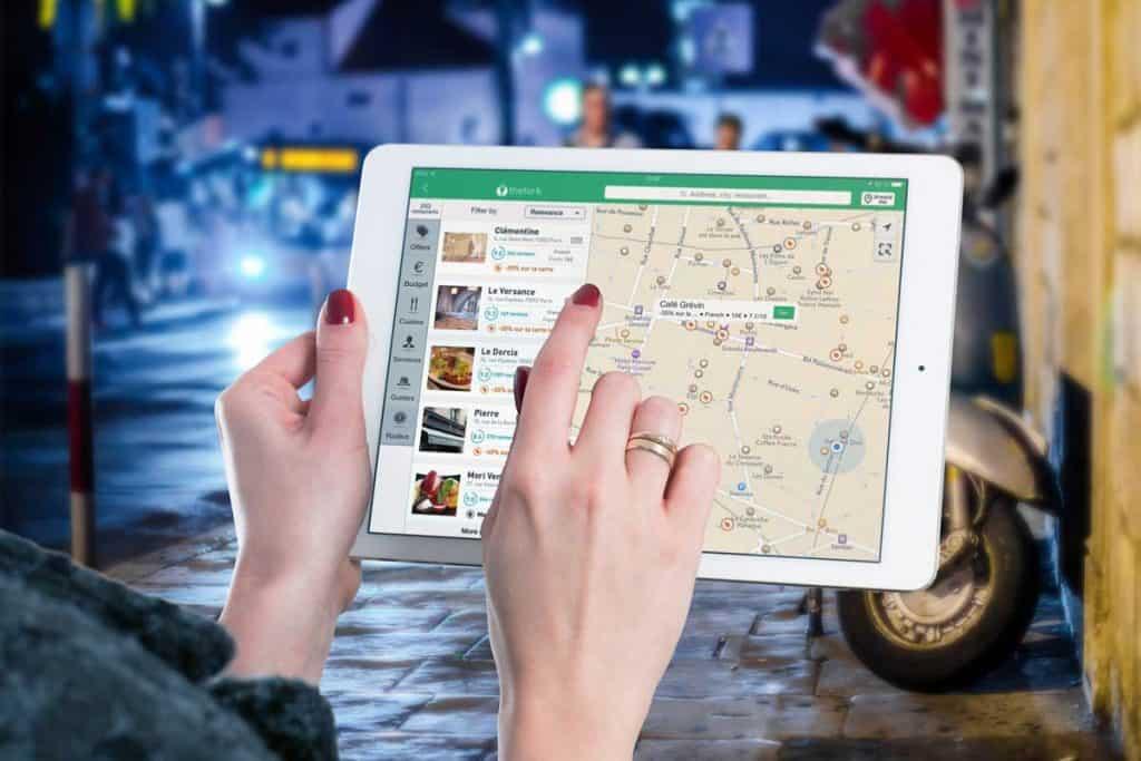 woman using ipad mini to navigate the map using GPS