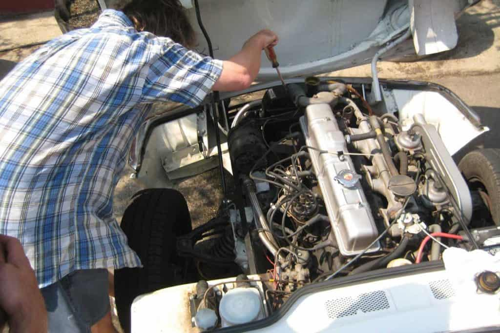 Mechanic fixing car, Engine problem