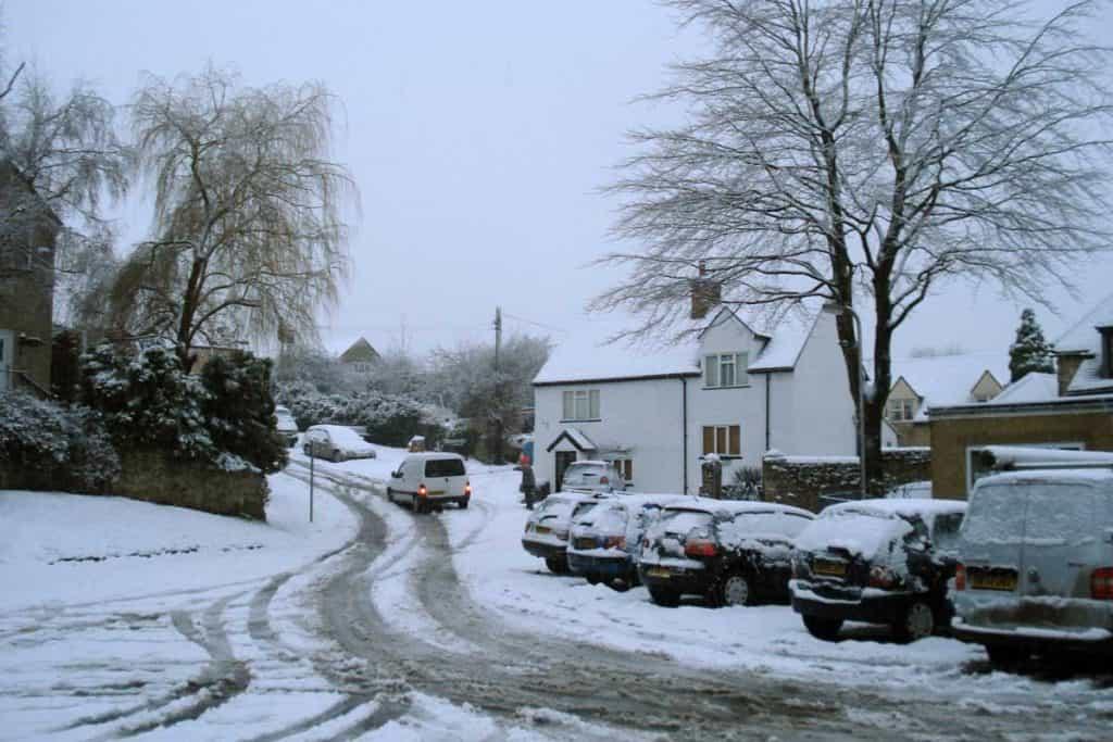 Minivan slipping on snow, snowy road, winter