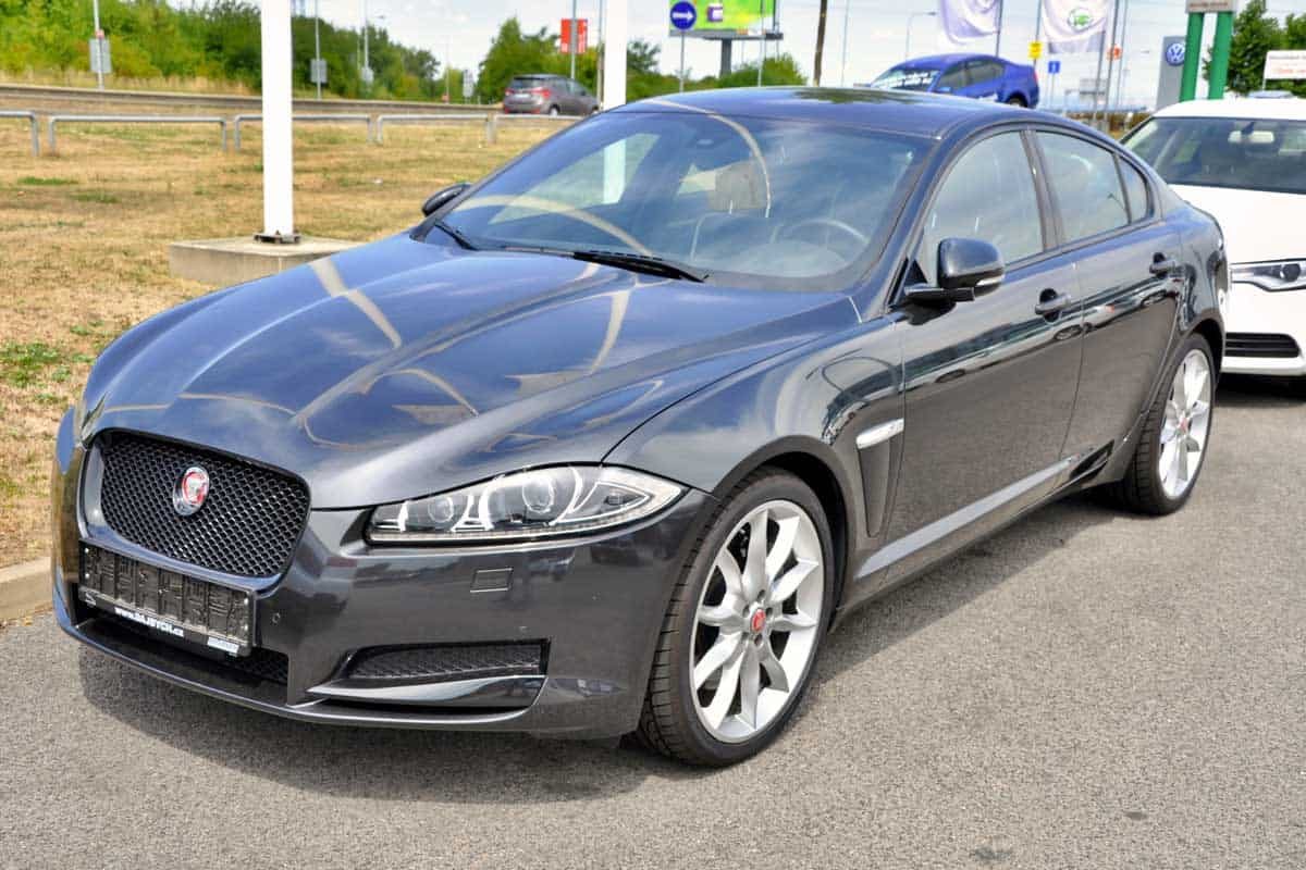 Brand-new-Jaguar-XF-parking-in-front-of-Car-Store-in-Prague