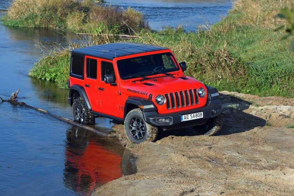 Red Jeep Wrangler Rubicon crossing stream, How Much Can a Jeep Wrangler Tow?