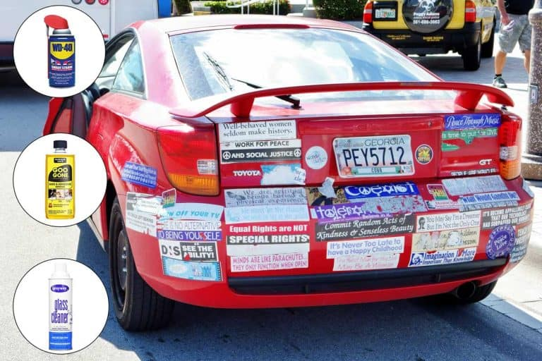 A Toyota automobile completely covered with stickers is parked on a downtown West Palm Beach street