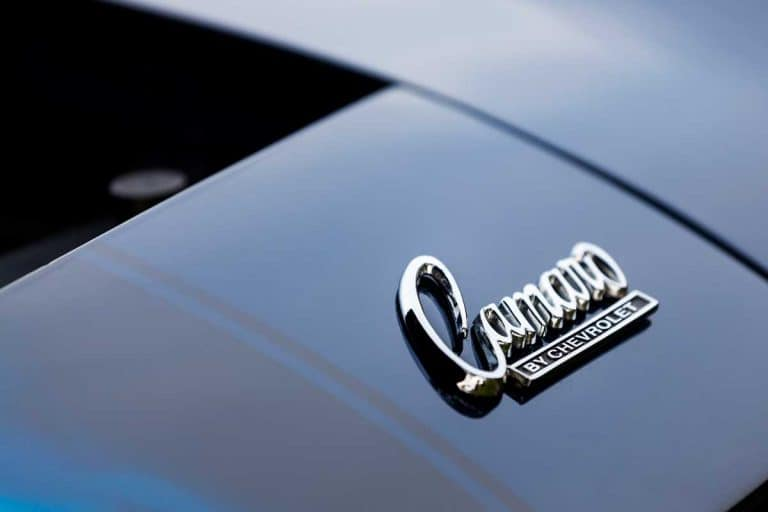 Chevrolet Camaro emblem (Camaro by Chevrolet) on hood of vehicle. Debadging a car