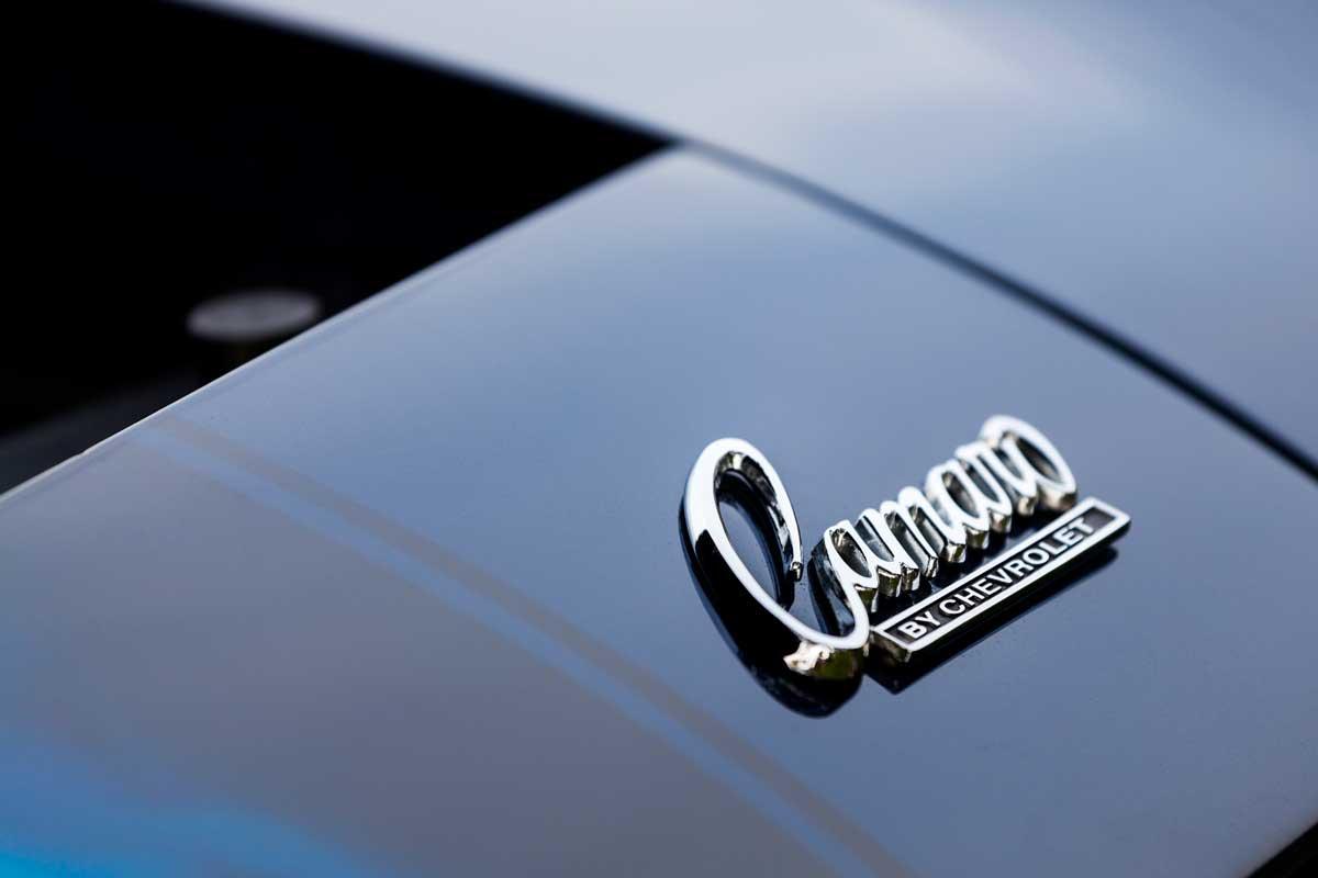 Chevrolet Camaro emblem (Camaro by Chevrolet) on hood of vehicle. Debadging a car