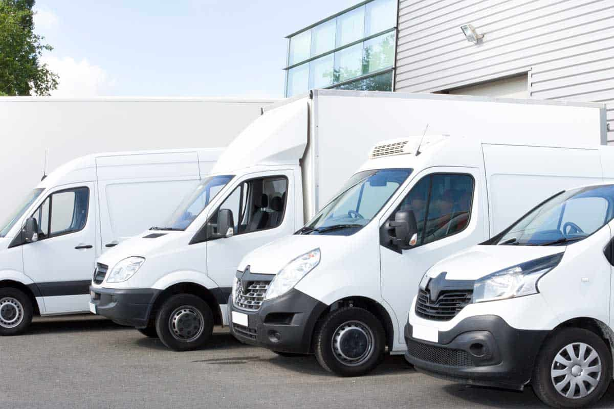 Commercial car, truck and van parked in parking lot for rent or delivery
