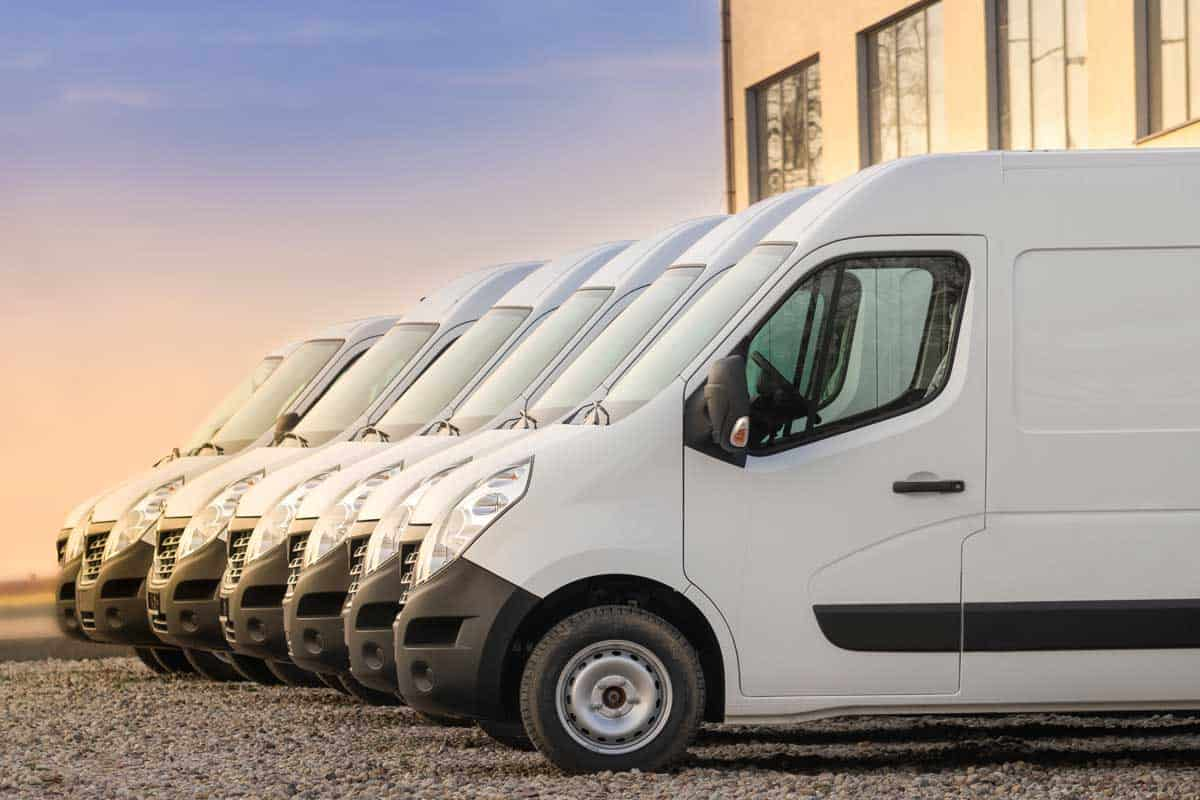 Commercial delivery vans parked in row