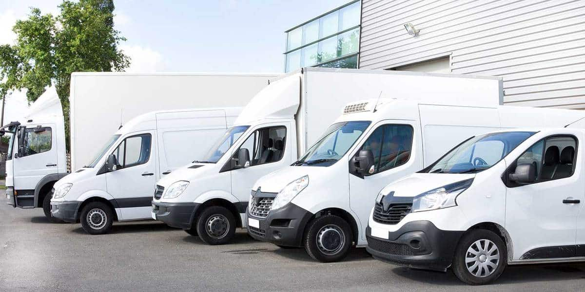 Commercial vehicles for rent or delivery lined up in parking lot