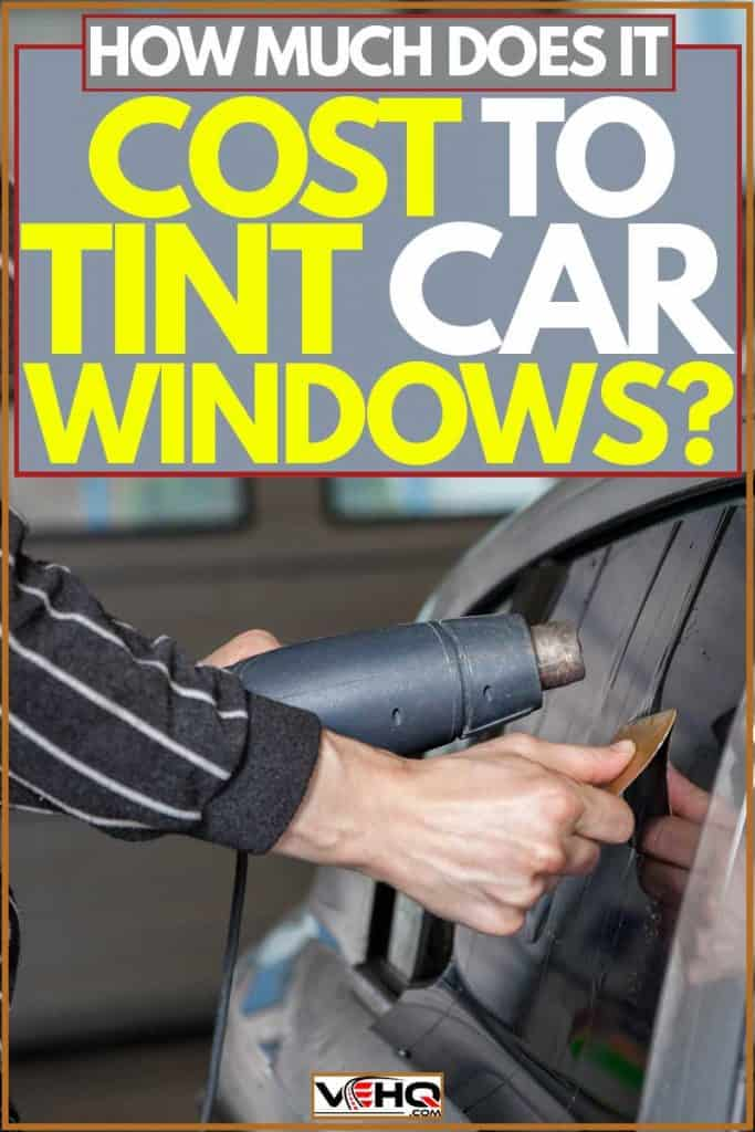 Car specialist applying car tint on car window, How Much Does it Cost to Tint Car Windows?