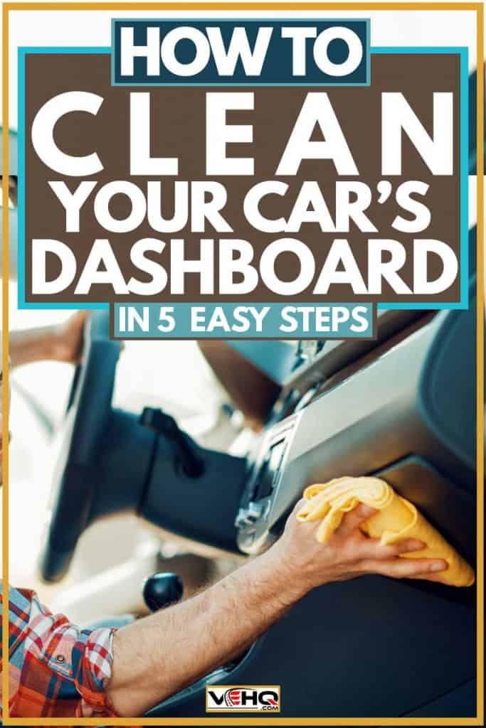 Man cleaning car dashboard using yellow cloth