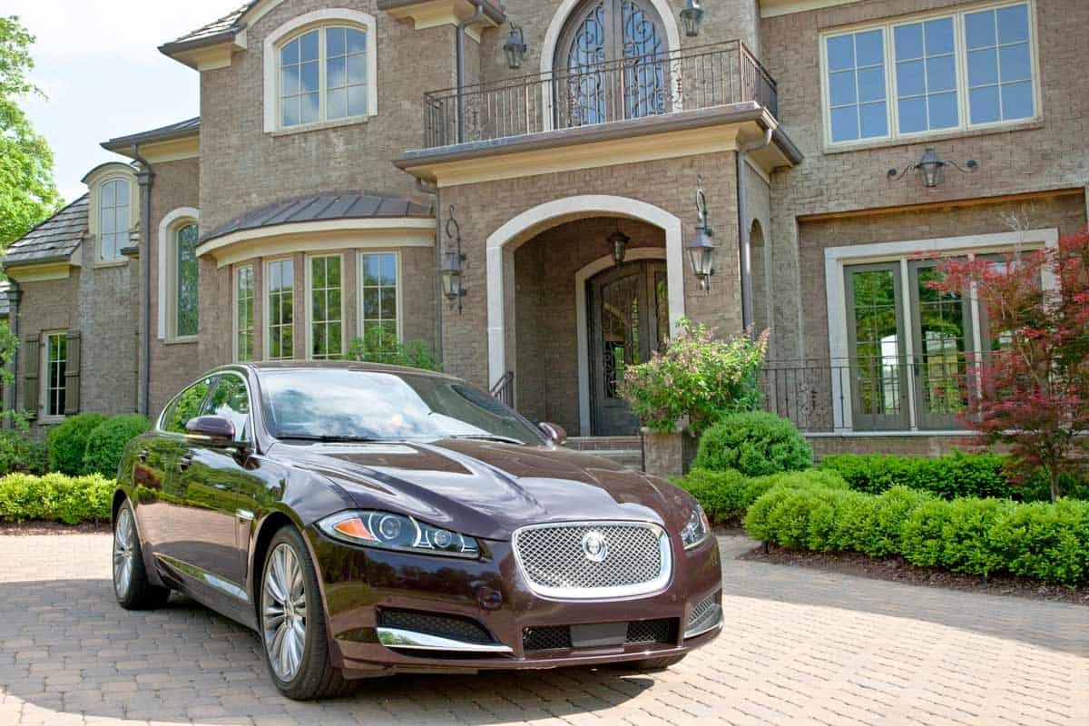 Maroon Jaguar XF at Porte Cochere in front of Mansion