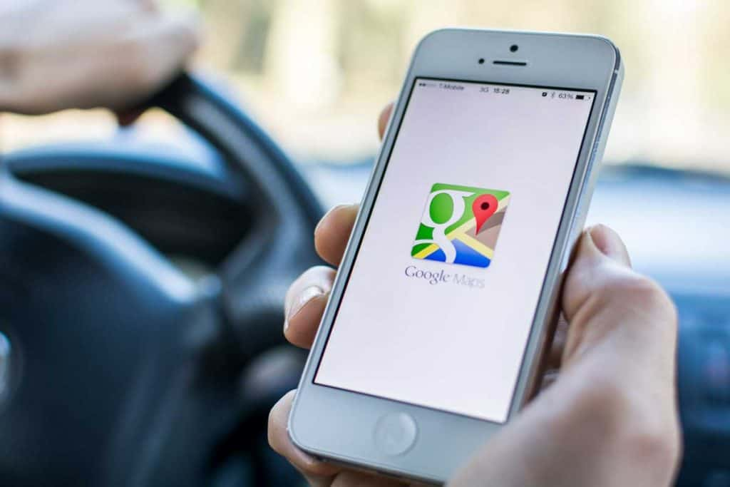 Man opening google maps to use for tracking car