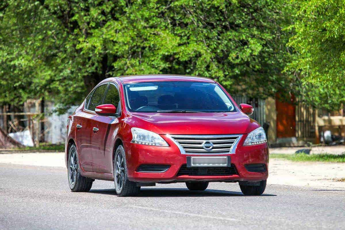 Red Nissan Sentra on the streets