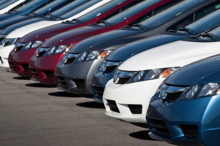 Row of new Honda Civic automobiles parked outside
