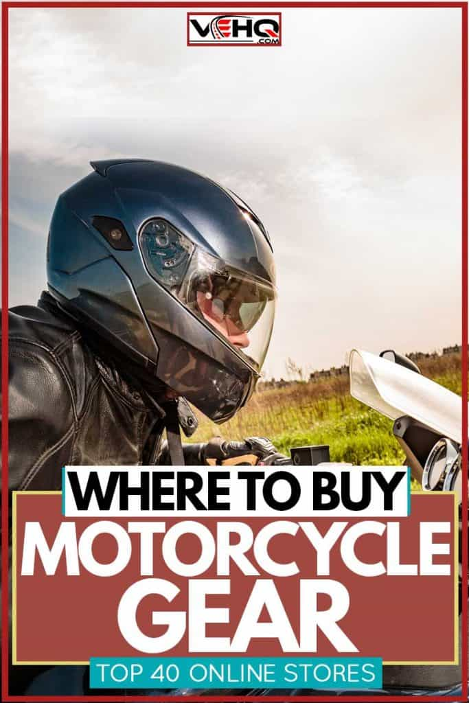 Motorcycle rider with helmet and jacket ducking down and revving up to accelerate