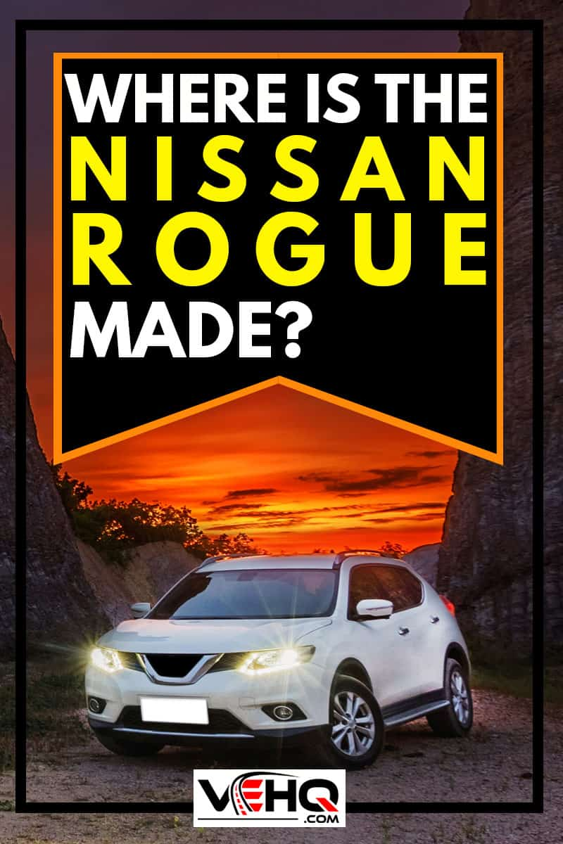 White Nissan Rogue on the road to mountain
