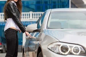 A woman trying to steal a borrowed car, Reporting A Car Stolen When Borrowed - Can You Do That?