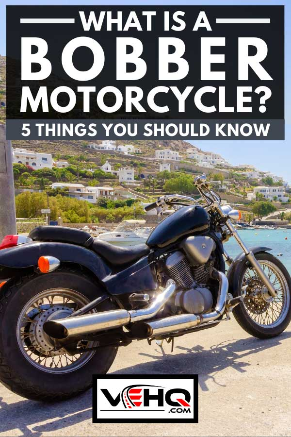 An old vintage bobber motorcycle parked by the beach, What Is A Bobber Motorcycle? [5 Things You Should Know]