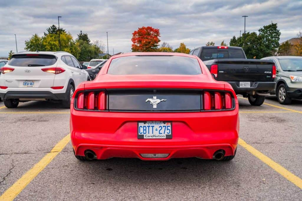 Red ford GT mustang showing license plate