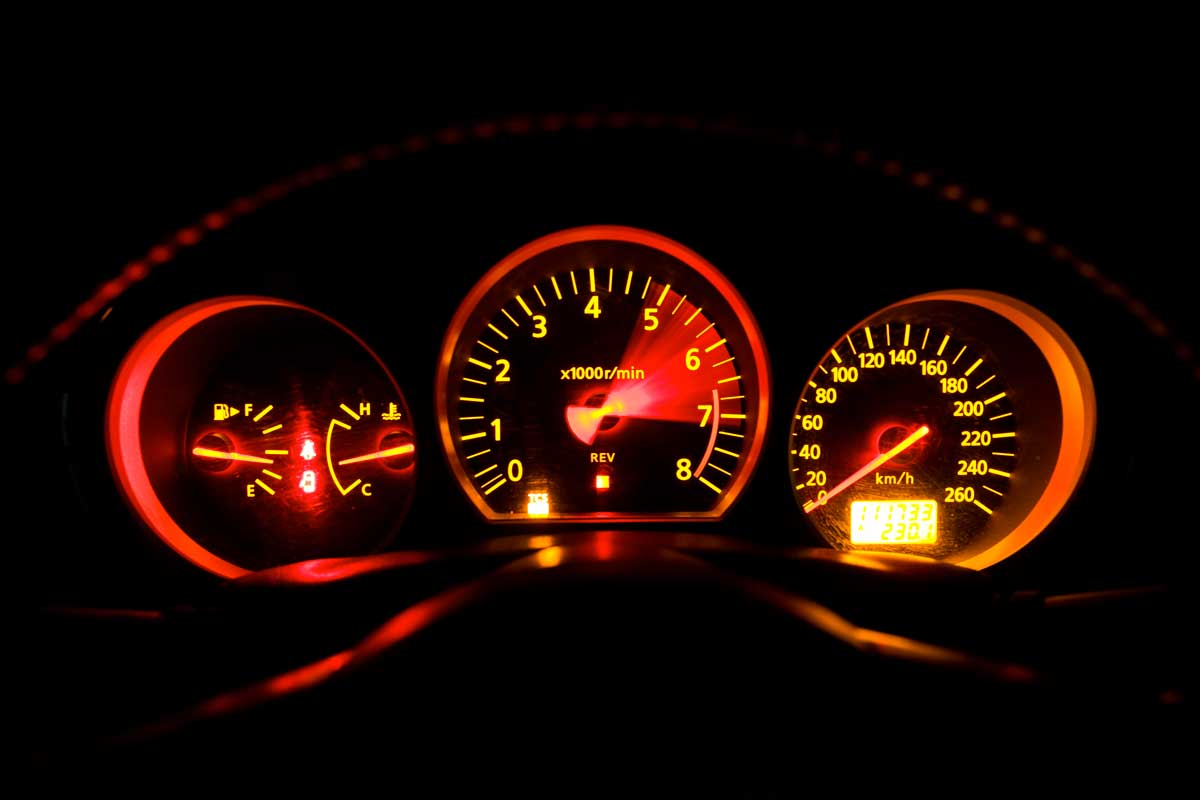 The Dashboard of a Sports Car with the revs in motion!