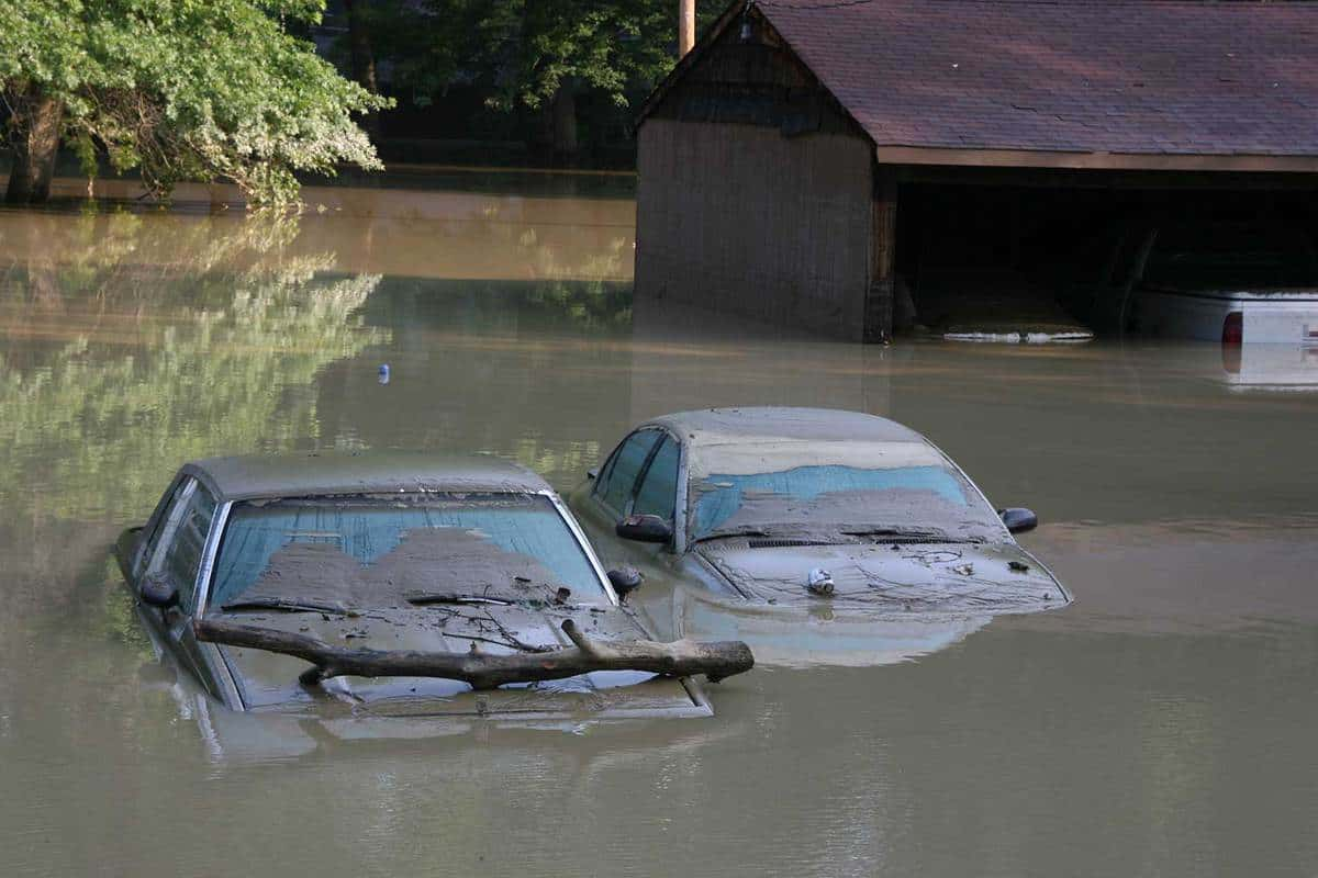 Two cars almost covered in mood and water during flood in Ohio