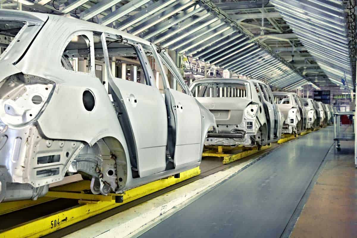 Assembled cars chassis in a row at car plant