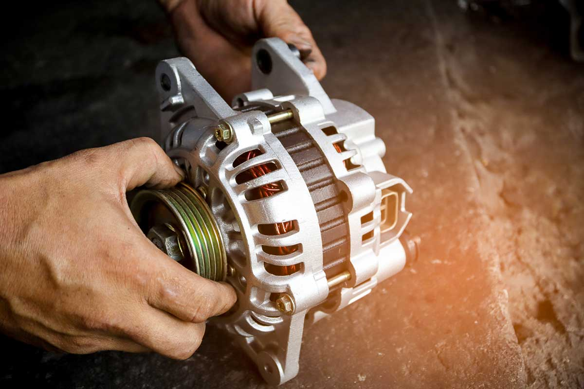 Change new car alternator with hand in the garage or auto repair service center, as background automotive concept.