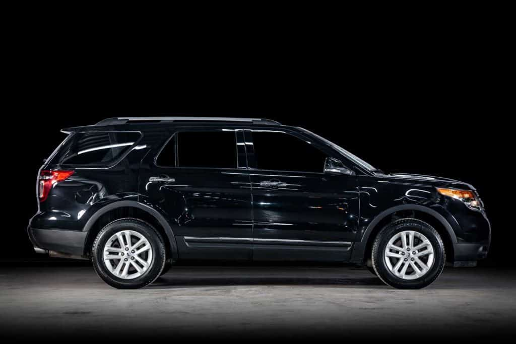 Ford Explorer, side view. Photography of a modern car on a parking
