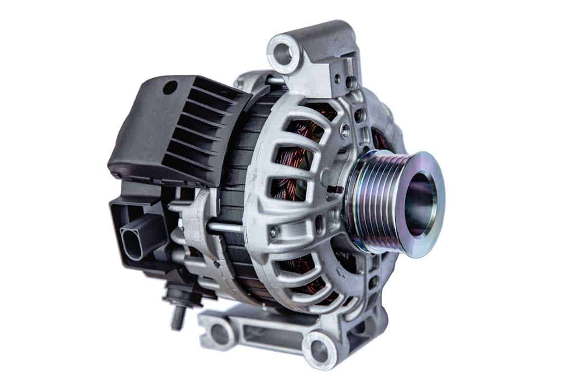 car alternator with shallow depth of field on white background