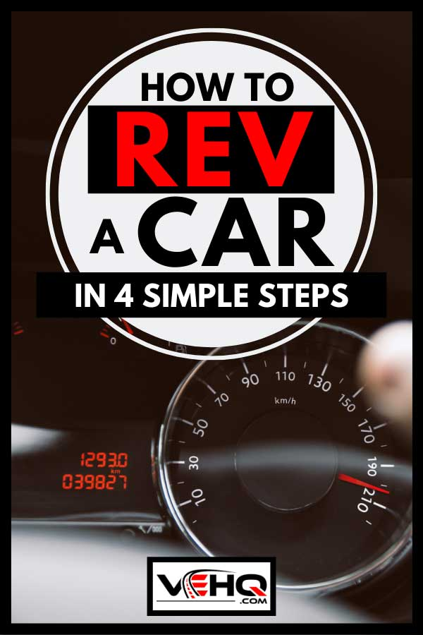 Man holds steering wheel revving his car, How To Rev A Car in 4 Simple Steps