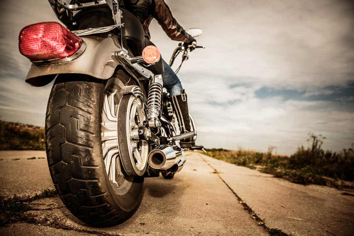 Rear view of a biker riding a motorcycle